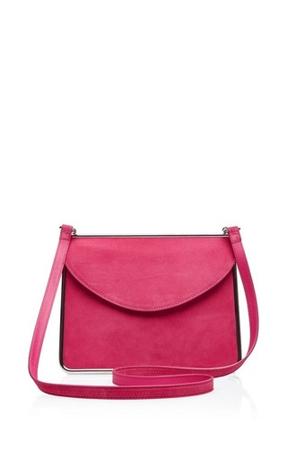 Suede shoulder bag in fuschia by CARVEN Available Now on Moda Operandi