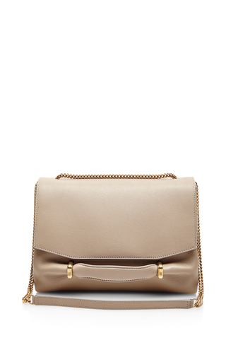 Marche leather and suede clutch by NINA RICCI Available Now on Moda Operandi