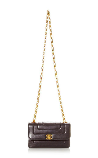 Vintage Chanel Black Quilt Half Flap Bag from What Goes Around Comes Around by What Goes Around Comes Around for Preorder on Moda Operandi