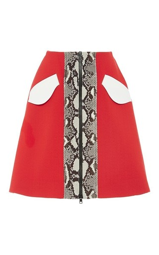 Mini skirt with snakeskin printed front panel by CARVEN Available Now on Moda Operandi