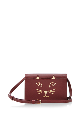 Burgundy calf leather feline crossbody   by CHARLOTTE OLYMPIA Available Now on Moda Operandi