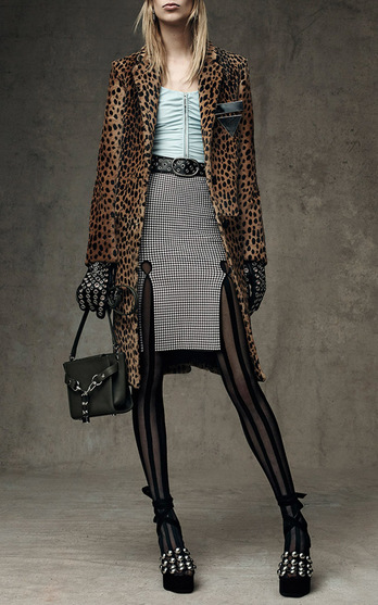 f1a8432e5b951 Cheetah overcoats worn with striped stockings