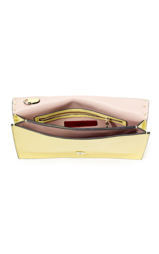 Soft Yellow Rockstud Flap Clutch With Laquered Studs by VALENTINO Now Available on Moda Operandi