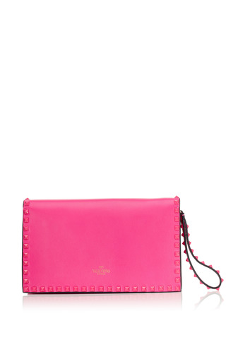 Pop Fuchsia Rockstud Flap Clutch With Laquered Studs by VALENTINO Now Available on Moda Operandi