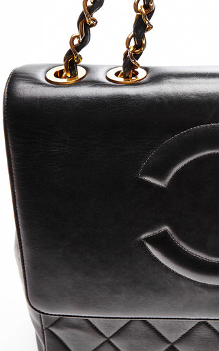 "Chanel Black Lambskin Jumbo ""Coco"" Bag From What Goes Around Comes Around by COLLECTIBLE JACKETS for Preorder on Moda Operandi"