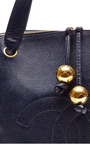 Chanel Navy Caviar Embossed Tote Bag From What Goes Around Comes Around by COLLECTIBLE JACKETS for Preorder on Moda Operandi