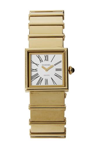 Medium what goes around comes around gold vintage chanel 18k yellow gold watch