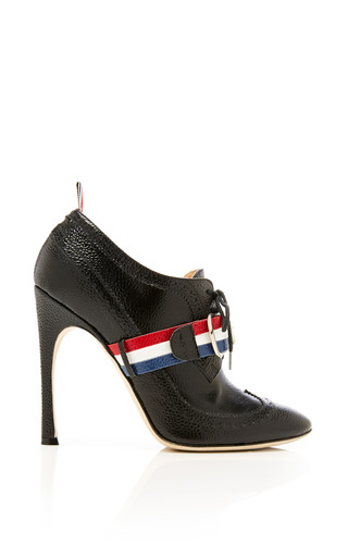 Wingtip Brogue Heel In Black Mati Patent Pebble Grain by THOM BROWNE for Preorder on Moda Operandi
