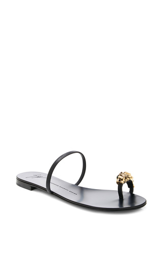 Medium giuseppe zanotti black flat sandal with gold emerald lion