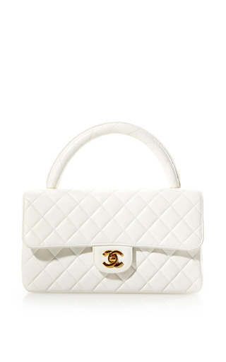 Medium what goes around comes around white vintage chanel white leather handle bag from what goes around comes around