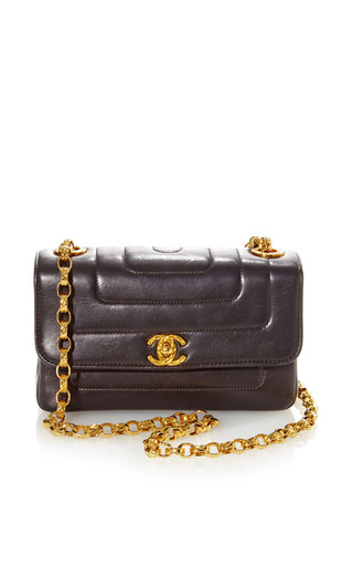 Medium what goes around comes around black vintage chanel black quilt half flap bag from what goes around comes around