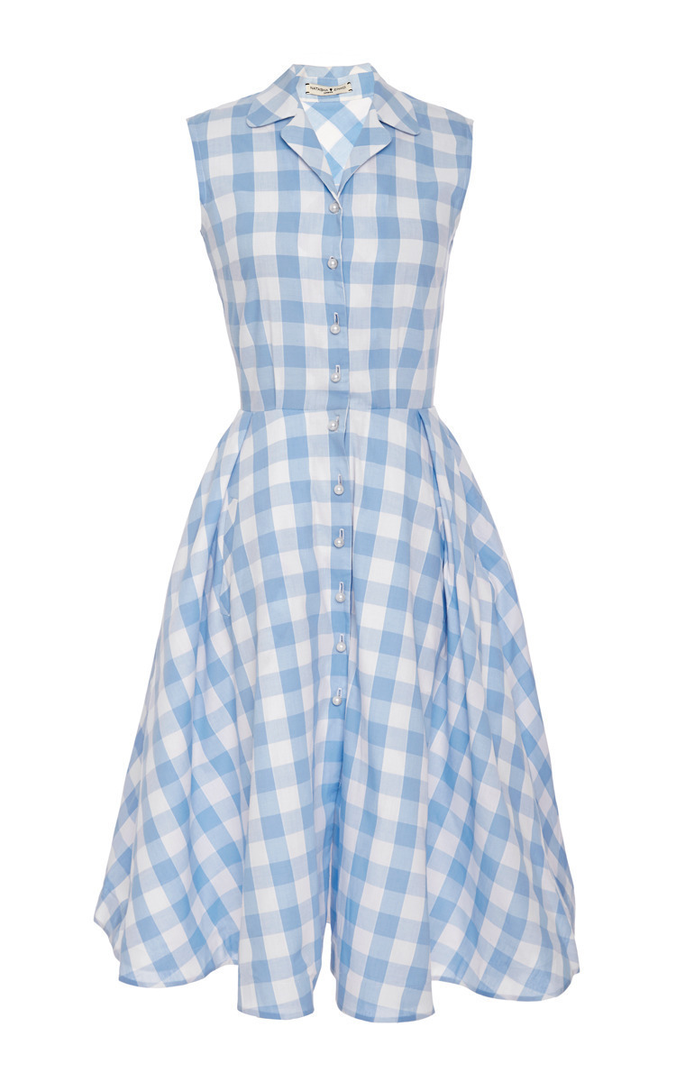 With a crisp two-colour check, this wrap dress is crafted from a plain weave of organic cotton. The short-sleeve top has a relaxed fit, featuring a collar with lapels and two patch pockets. Furbished with a fitted waist and an A-line skirt, cut at a mid-calf length, the dress has a feminine silhouette. Tie bands at waist Wide buttoned cuffs Mother of pearl buttons (meaning this product.