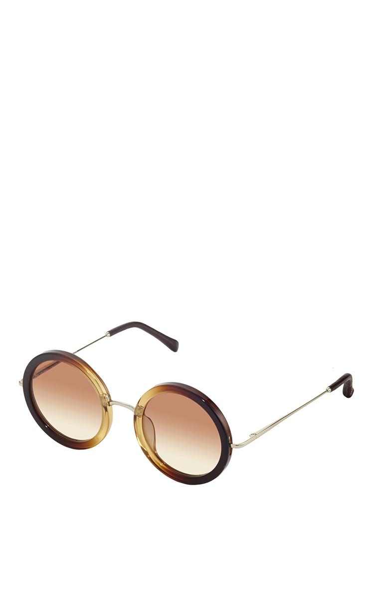 1b62e03363e Linda FarrowJohn Lennon Inspired Sunglasses X The Row. CLOSE. Loading.  Loading