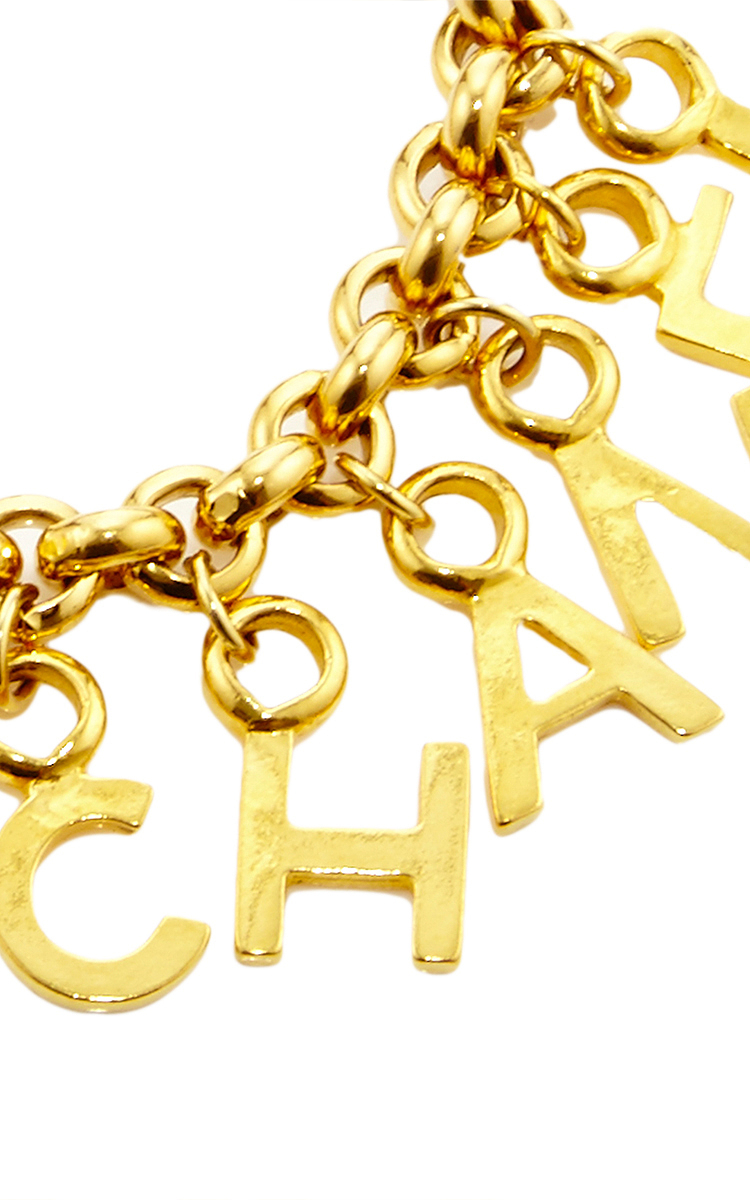 chanel gold letters charm bracelet by what goes around