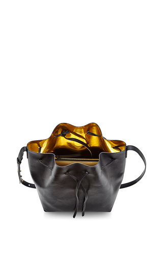 Vegetable Tanned Bucket Bag In Black With Gold by MANSUR GAVRIEL Now Available on Moda Operandi