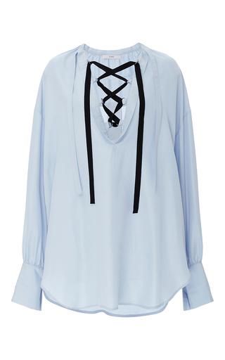 Medium tome light blue lace up blouse