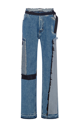 Medium tome blue tailored jeans with patches