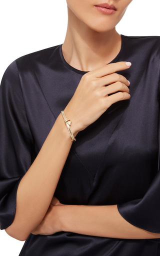 18 K Yellow Gold Knot Bangle by CARELLE Now Available on Moda Operandi