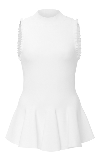 Medium carven white sleeveless peplum blouse