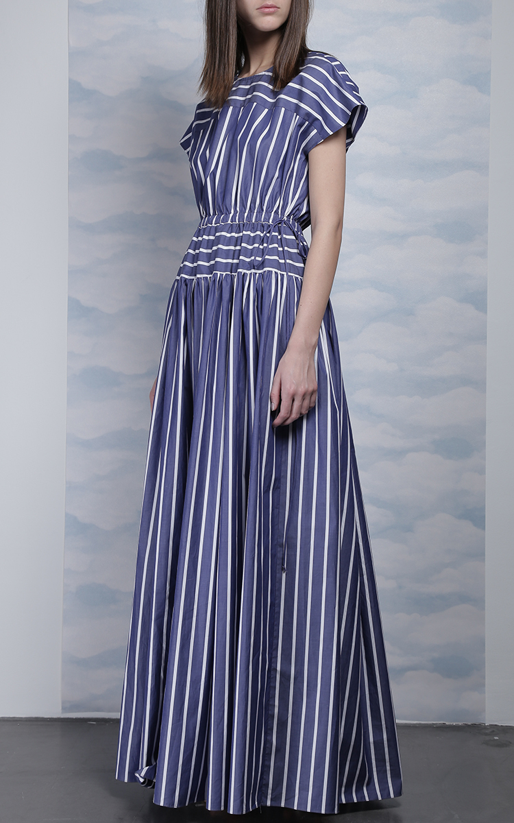 A ruffle trim and flutter sleeves complements a striped challis wrap dress that's lightweight and breathable.