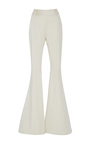 Bone Navi Flared Trousers by BEAUFILLE for Preorder on Moda Operandi