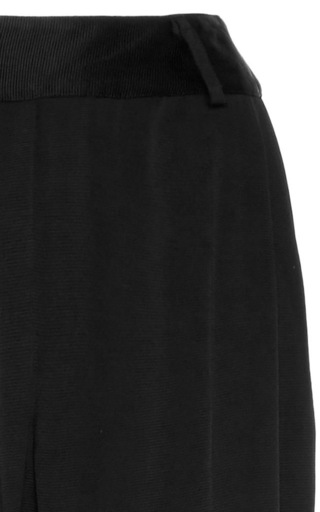 Black Navi Flared Trousers by BEAUFILLE for Preorder on Moda Operandi