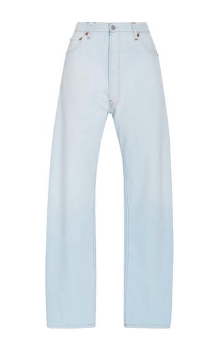 Medium re done light wash ultra high rise straight leg sunfaded denim jeans