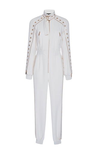 Medium elie saab white long sleeved zipped jumpsuit with metal eyelet detail