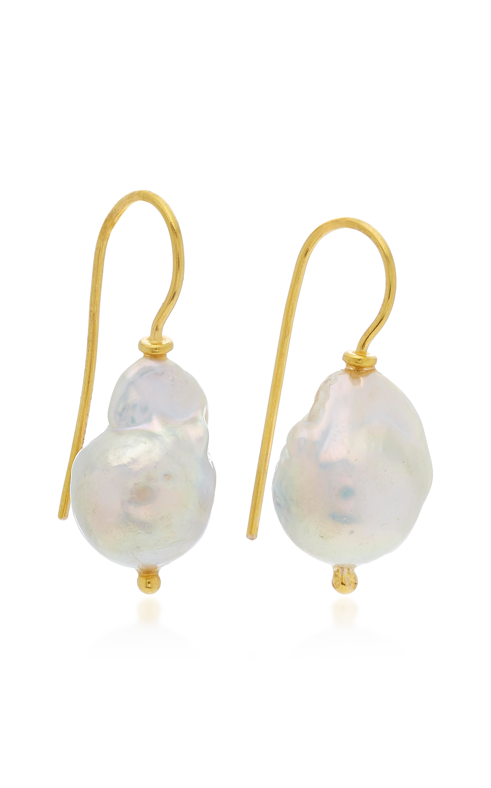 understated to crystal handmade swarovski of candela teardrops earrings reflects cool glow pin single a pearl drawing its light the eye off