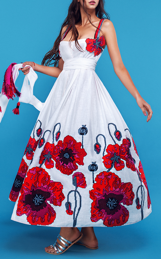 This Yuliya Magdych Poppies Floral Embroidered Sundress features a fit and flare silhouette with a low square neckline, thin straps, front snaps closure and waist tie for cinching.