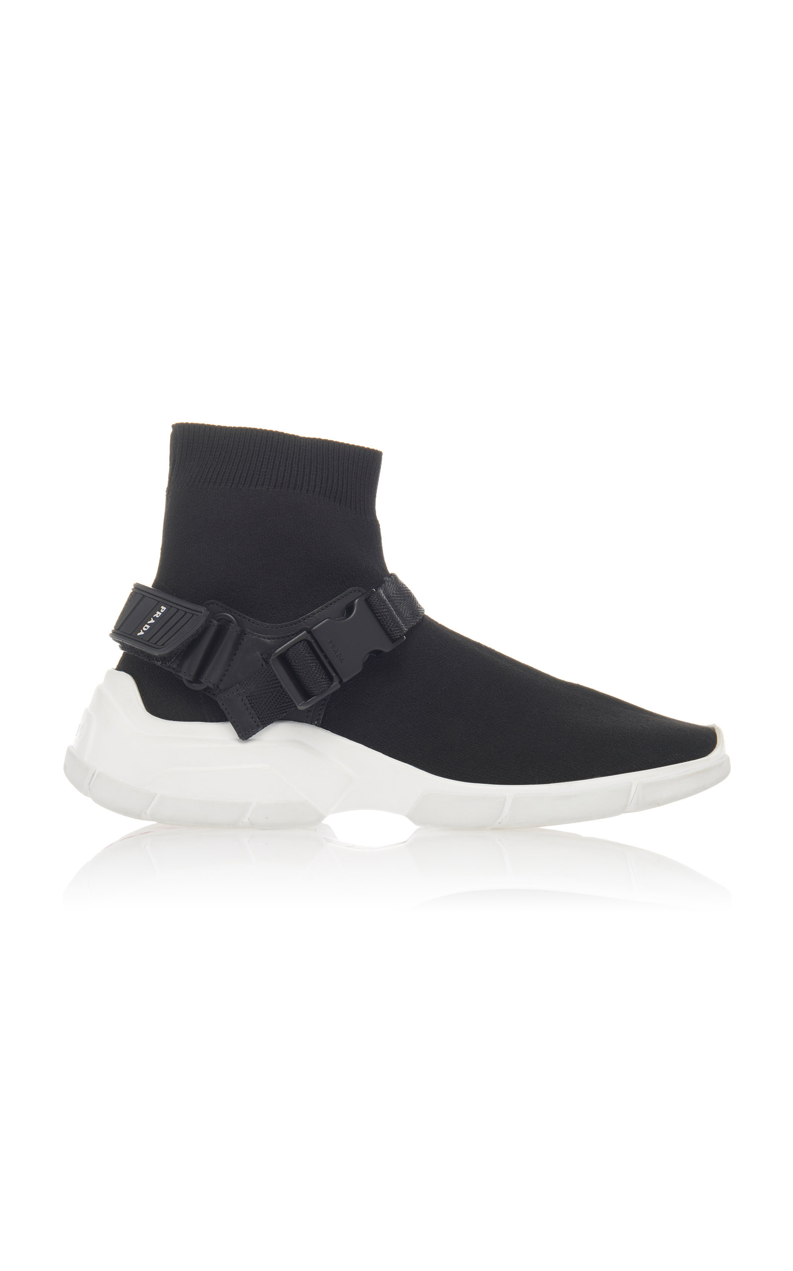 BUCKLED RUBBER-TRIMMED STRETCH-KNIT SNEAKERS