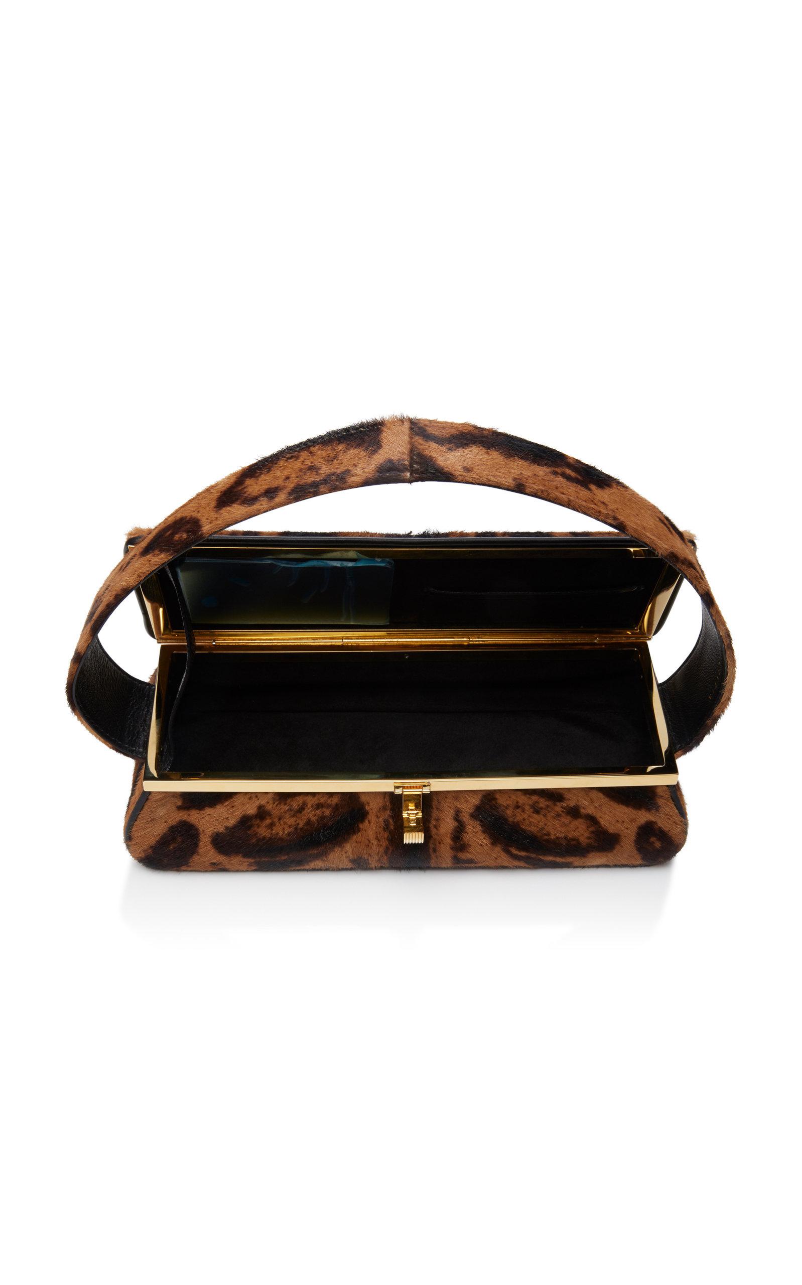5584bb35ed4e Victoria BeckhamPowder Leopard-Print Calf Hair Clutch. CLOSE. Loading.  Loading. Loading. Loading