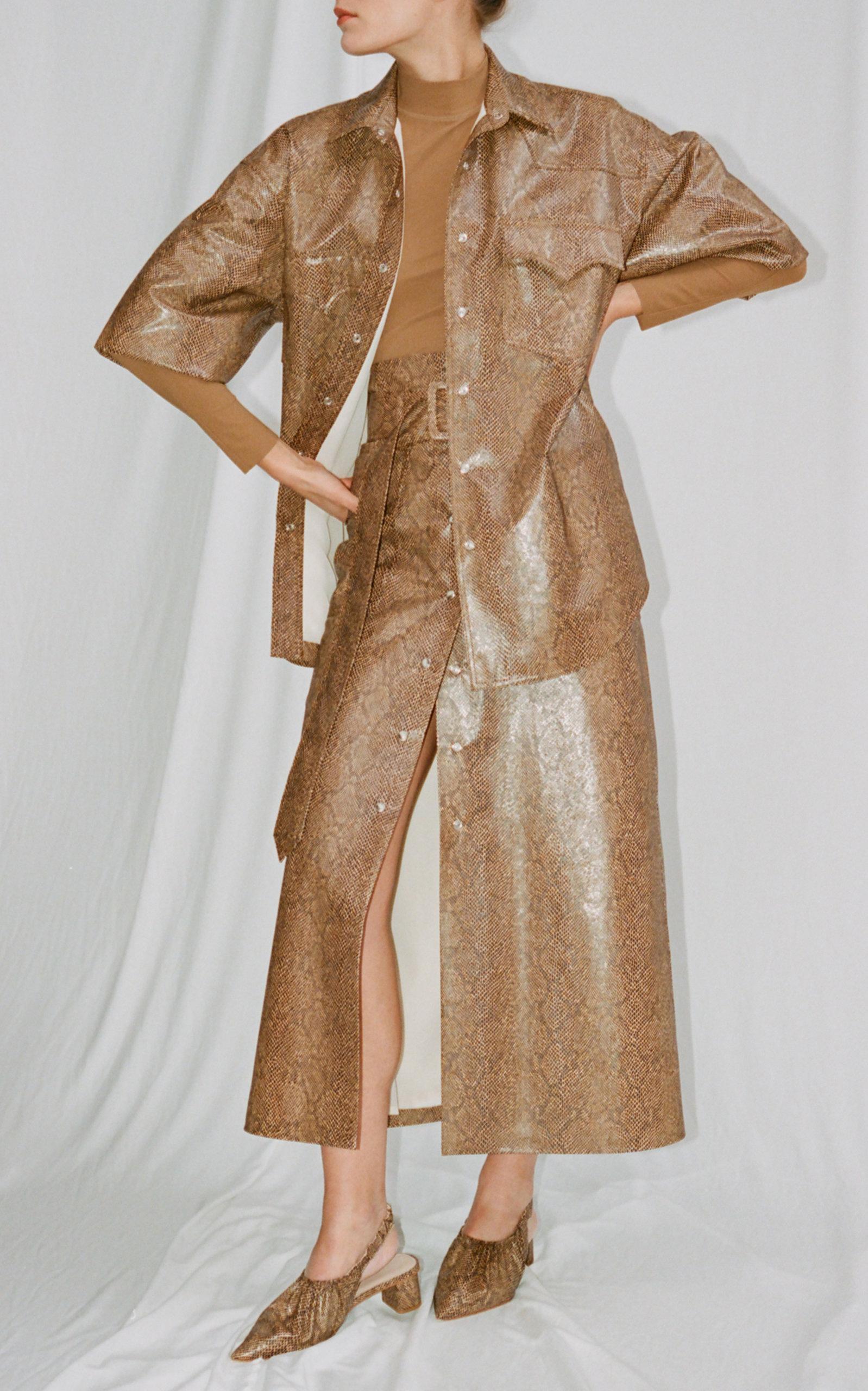 070bc9f985 NanushkaAarohi Belted A-Line Vinyl Midi Skirt. CLOSE. Loading. Loading.  Loading. Loading