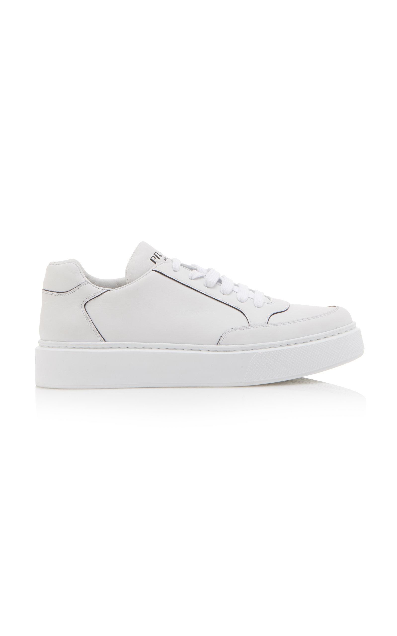 PRADA | Prada Logo-Printed Leather Sneakers | Goxip