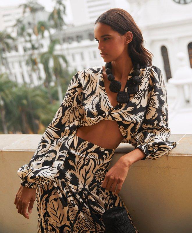 Woman in Altuzarra dress