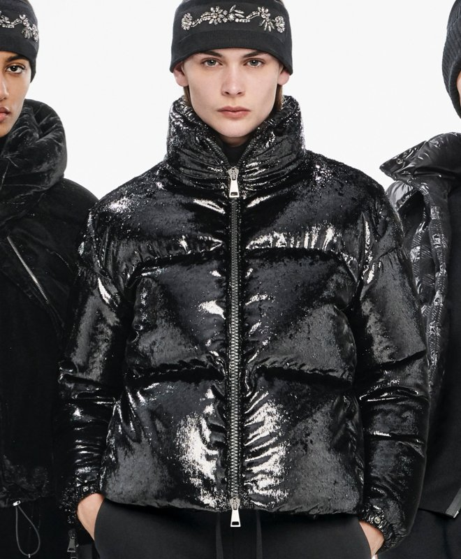 Woman in a black Moncler puffer jacket