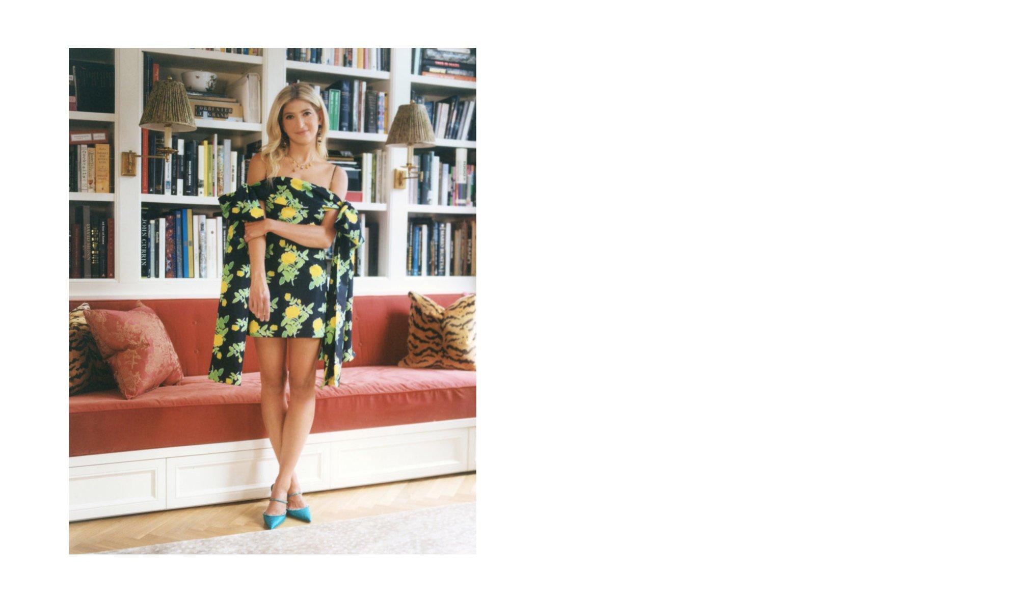 Sarah Hoover standing in her home in a Bernadette Antwerp dress