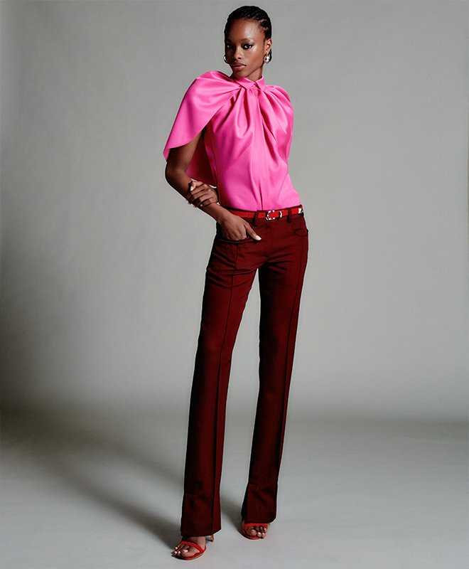 Woman in a pink top and red pants