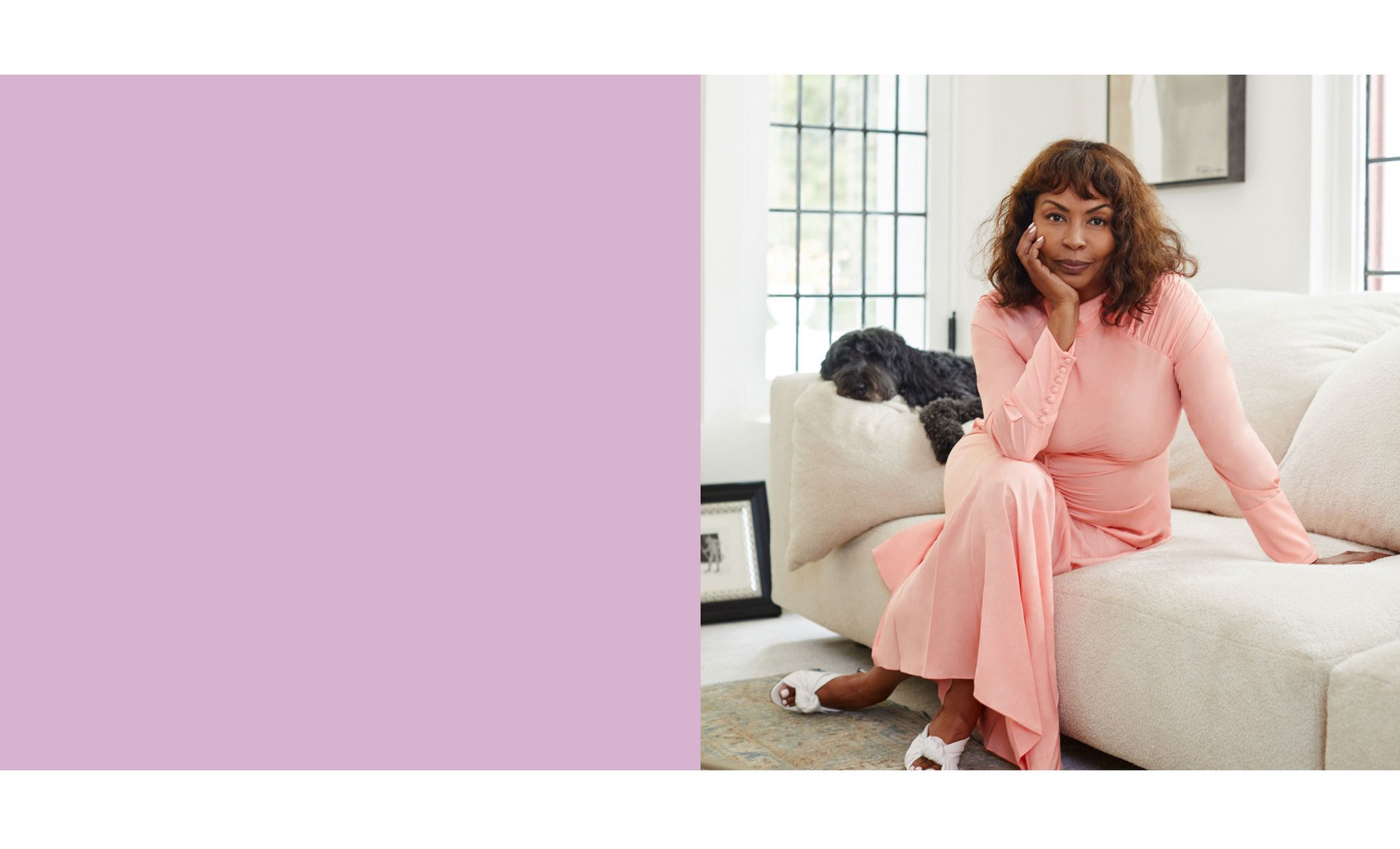 Brigette Romanek sitting in her home in an Anna October dress