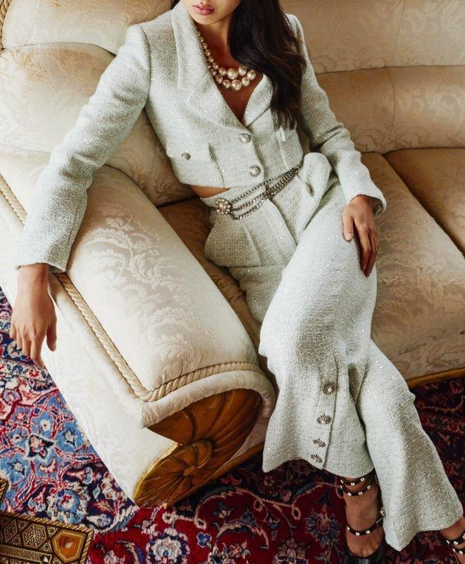 Woman in mint suit
